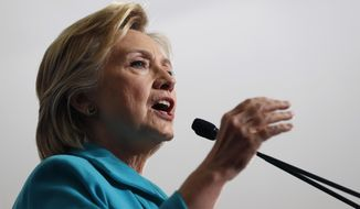 Hillary Clinton said Donald Trump has shown by whom he hires, what he tweets, how he attacked President Obama's birth, his stance on immigration and the attraction white nationalists have for him that he is the most dangerous major-party candidate in modern history. (Associated Press)