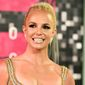 """Britney Spears arrives at the MTV Video Music Awards in Los Angeles in this Aug. 30, 2015, file photo. In an August 24 interview on BBC One promoting her forthcoming album, """"Glory,"""" Ms. Spears said she almost drowned recently while on vacation in Hawaii.  (Photo by Jordan Strauss/Invision/AP, File) **FILE**"""