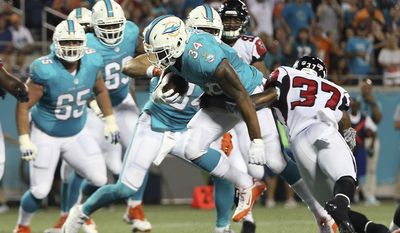 Miami Dolphins' Arian Foster (34) runs for a 2-yard touchdown past Atlanta Falcons free safety Ricardo Allen (37) during the first half of an NFL preseason football game in Orlando, Fla., Thursday, Aug. 25, 2016.(AP Photo/Willie J. Allen Jr.)