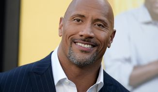 """Dwayne Johnson attends the premiere of his film """"Central Intelligence"""" in Los Angeles, June 10, 2016. Johnson is the highest-paid actor with a fast and furious income of $64.5 million, according to Forbes magazine. Johnson, the former wrestler whose income swelled thanks to the films """"Central Intelligence"""" and """"Fast 8,"""" beat out Jackie Chan with $61 million and Matt Damon, who earned $55 million. (Photo by Richard Shotwell/Invision/AP) ** FILE **"""