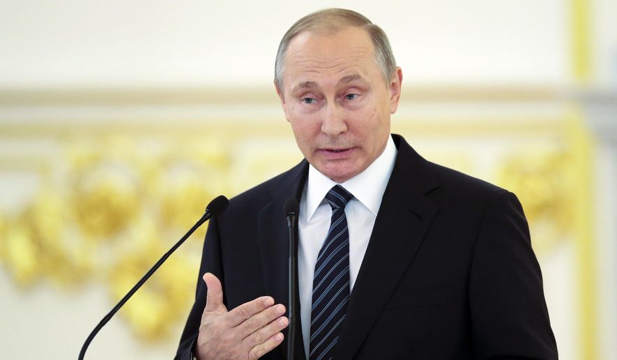 Russian President Vladimir Putin gestures as he speaks during an awarding ceremony for Russia's Olympians in Moscow's Kremlin in Moscow, Russia, Thursday, Aug. 25, 2016. Russian President Vladimir Putin on Thursday attacked the ban on his country from the Rio de Janeiro Paralympics as immoral and inhumane. (AP Photo/Ivan Sekretarev)