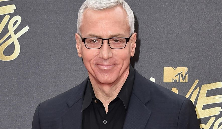"In this April 9, 2016 file photo, Drew Pinsky arrives at the MTV Movie Awards in Burbank, Calif. Pinsky's show ""Dr. Drew,"" has been canceled by the HLN network. His last episode will air on Sept. 22.  (Photo by Jordan Strauss/Invision/AP, File)"