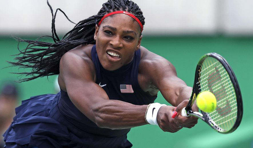 FILE - In this Aug. 7, 2016, file photo, Serena Williams, of the United States, reaches for a return against Daria Gavrilova, of Australia, at the 2016 Summer Olympics in Rio de Janeiro, Brazil.  The first round of the U.S. Open tennis tournament is scheduled for Monday, Aug. 29. (AP Photo/Charles Krupa, File)