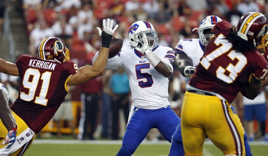 Buffalo Bills quarterback Tyrod Taylor (5) looks to pass under pressure from Washington Redskins outside linebacker Ryan Kerrigan (91) during the first half of an NFL preseason football game Friday, Aug. 26, 2016, in Landover, Md. (AP Photo/Alex Brandon)