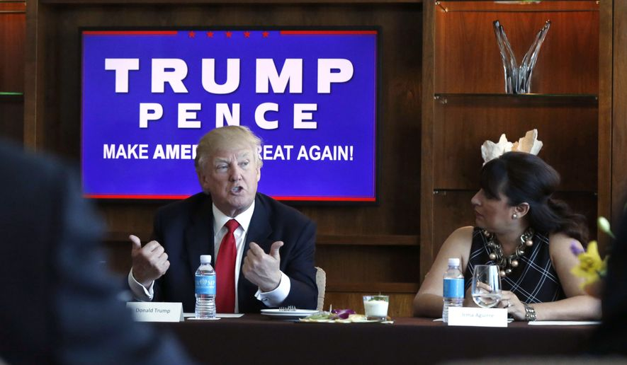 Republican presidential candidate Donald Trump leads a Hispanic leaders and small business owners roundtable in Las Vegas, Friday, Aug. 26, 2016. Right is Irma Aguirre, a local business owner. (AP Photo/Gerald Herbert)