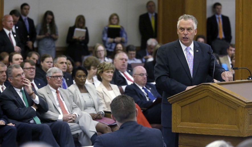 Gov. Terry McAuliffe, right, addresses a joint meeting of the House Appropriations and Senate Finance committees at the General Assembly Building in the General Assembly Building in Richmond, Va., Friday, Aug. 26, 2016.  (Bob Brown/Richmond Times-Dispatch via AP)