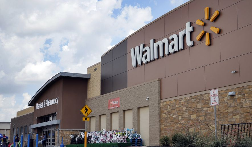 Persons walk in and out of a Wal-Mart store, Friday, Aug. 26, 2016, in Dallas. (AP Photo/Tony Gutierrez) ** FILE **