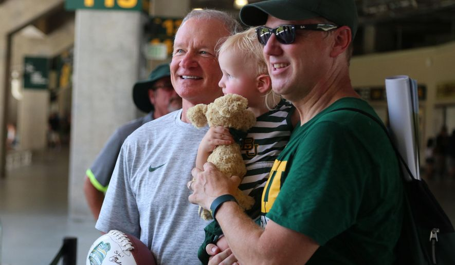 "In this Aug. 6, 2016, photo, acting head coach Jim Grobe poses for a photo during the annual ""Meet the Bear's,""  at McLane Stadium in Waco, Texas. Thousands of Baylor fans received autographs and visited with the 2016 football team. (Rod Aydelotte/Waco Tribune Herald, via AP) /Waco Tribune-Herald via AP)"