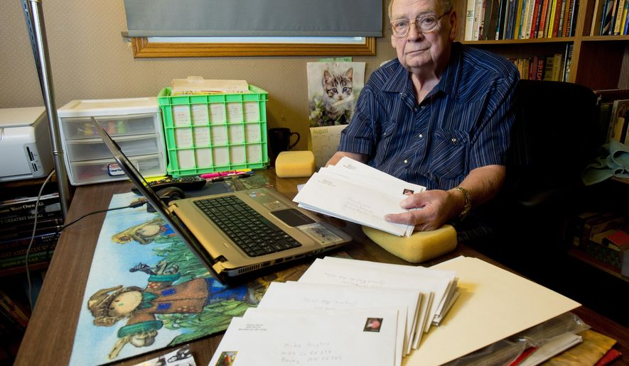 In this Aug. 17, 2016 photo, retired Gilbert High School English teacher Richard Roach, of Mountain Iron, Minn., shows off a few of the 3,000 student autobiographies he's saved over his decades of teaching. Roach is reaching out on Facebook to his former students to return the autobiographies to his students and give them a reminder of their younger selves. (Mark Sauer/The Mesabi Daily News via AP)