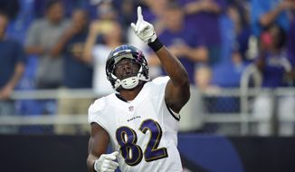 Baltimore Ravens tight end Benjamin Watson gestures as he is introduced before a preseason NFL football game against the Detroit Lions, Saturday, Aug. 27, 2016, in Baltimore. (AP Photo/Nick Wass)