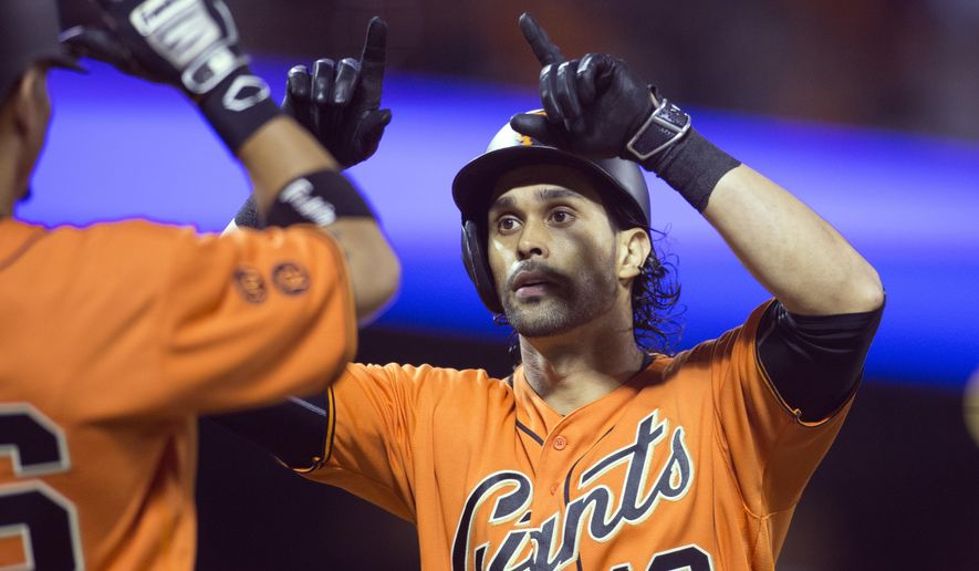 San Francisco Giants' Angel Pagan (16) is greeted by teammate Gorkys Hernandez after hitting a two-run home run off Atlanta Braves starting pitcher Joel De La Cruz during the second inning of a baseball game, Friday, Aug. 26, 2016, in San Francisco. (AP Photo/D. Ross Cameron)