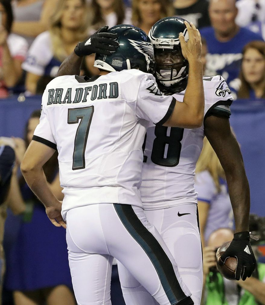 Philadelphia Eagles wide receiver Dorial Green-Beckham (18) celebrates a touchdown against the Indianapolis Colts with quarterback Sam Bradford (7) during the first half of an NFL preseason football game in Indianapolis, Saturday, Aug. 27, 2016. (AP Photo/AJ Mast)