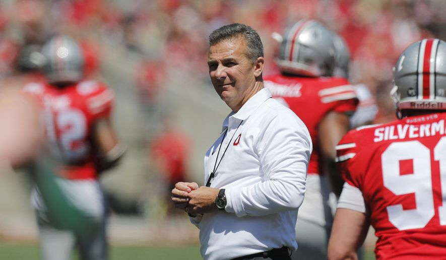 "FILE - In this April 16, 2016, file photo, Ohio State head coach Urban Meyer watches the team's NCAA college football spring game in Columbus, Ohio. ""The Edge,"" this season's motivational mantra for Ohio State football, is among the messages the program is using to help fire up millennial players in an age of social media, digital flash and diminished attention spans. Meyer says developing the messages forces coaches to think like 18-year-olds and motivate them to go as hard as they can. (AP Photo/Jay LaPrete, File)"