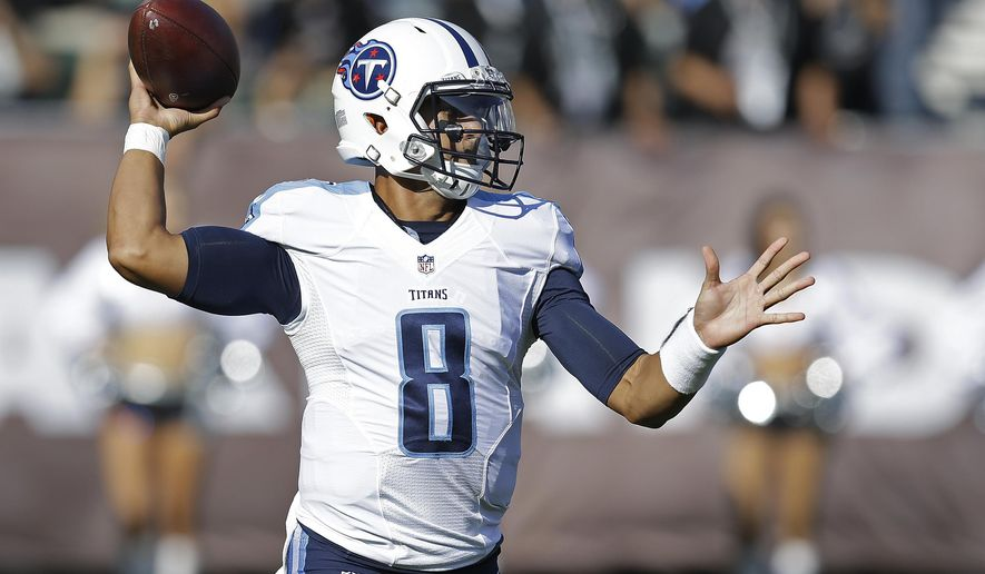 Tennessee Titans quarterback Marcus Mariota throws the ball during the first half of an NFL preseason football game against the Oakland Raiders Saturday, Aug. 27, 2016, in Oakland, Calif. (AP Photo/Ben Margot)