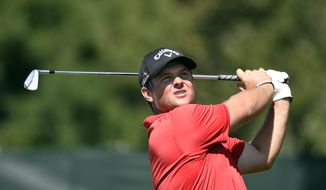 Patrick Reed watches his tees hot from the third hole during the final round of The Barclays golf tournament in Farmingdale, N.Y., Sunday, Aug. 28, 2016. (AP Photo/Kathy Kmonicek)