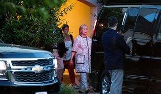Democratic presidential candidate Hillary Clinton, center, leaves a fundraiser at a private home in Southampton, N.Y., Sunday, Aug. 28, 2016. (AP Photo/Andrew Harnik)