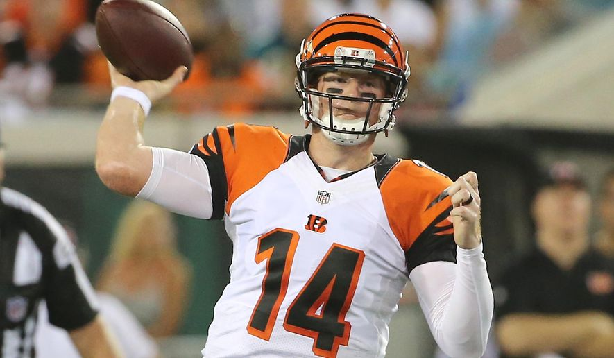 Cincinnati Bengals quarterback Andy Dalton (14) throws a pass against the Jacksonville Jaguars during the first half of an NFL preseason football game in Jacksonville, Fla., Sunday, Aug. 28, 2016.(AP Photo/Stephen B. Morton)
