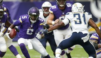 Minnesota Vikings quarterback Teddy Bridgewater (5) scrambles upfield ahead of San Diego Chargers cornerback Adrian Phillips (31) during the first half of an NFL preseason football game Sunday, Aug. 28, 2016, in Minneapolis. (AP Photo/Jim Mone) **FILE**
