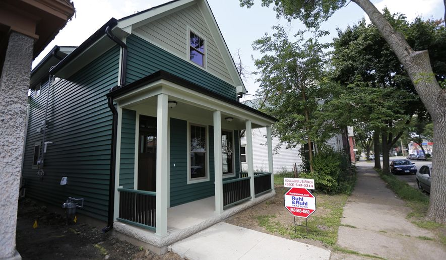 ADVANCE FOR WEEKEND EDITIONS AUG. 27-28 - This Tuesday, Aug. 16, 2016 photo shows one of the houses built by Dubuque Community Housing Initiatives near Washington and E. 18th streets in Dubuque, Iowa. Efforts to revitalize one of Dubuque's oldest neighborhoods will continue under a new agreement between the city and one of Iowa's largest nonprofit affordable housing providers. (Mike Burley/Telegraph Herald via AP)
