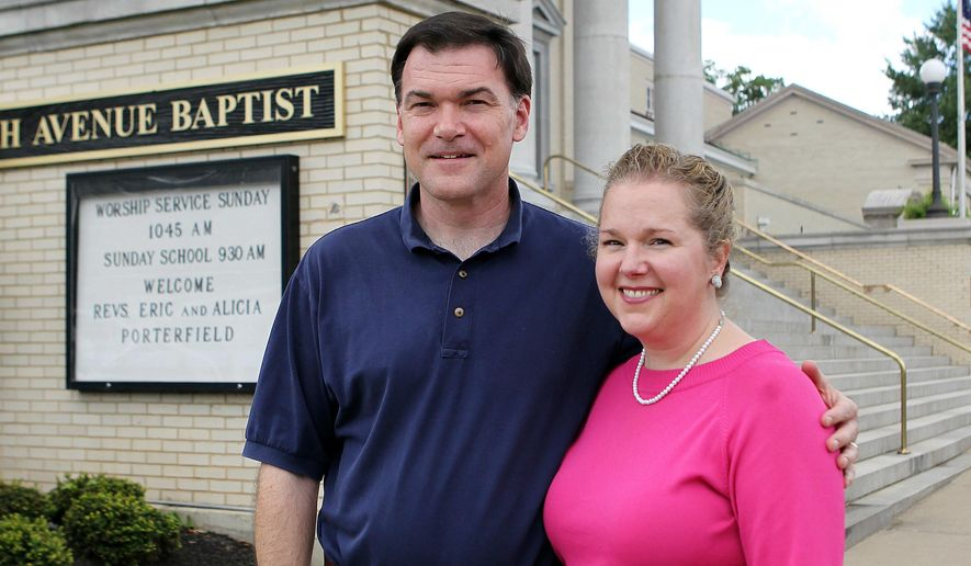 ADVANCE FOR MONDAY AUG 29, 2016 AND THEREAFTER - In this Aug. 16, 2016 photo, the new pastors at the Fifth Avenue Baptist Church Eric and Alicia Porterfield pose in front of the church in Huntington, W.Va. Eric is the senior pastor and Alicia is associate pastor of adult education. (Lori Wolfe/The Herald-Dispatch via AP)