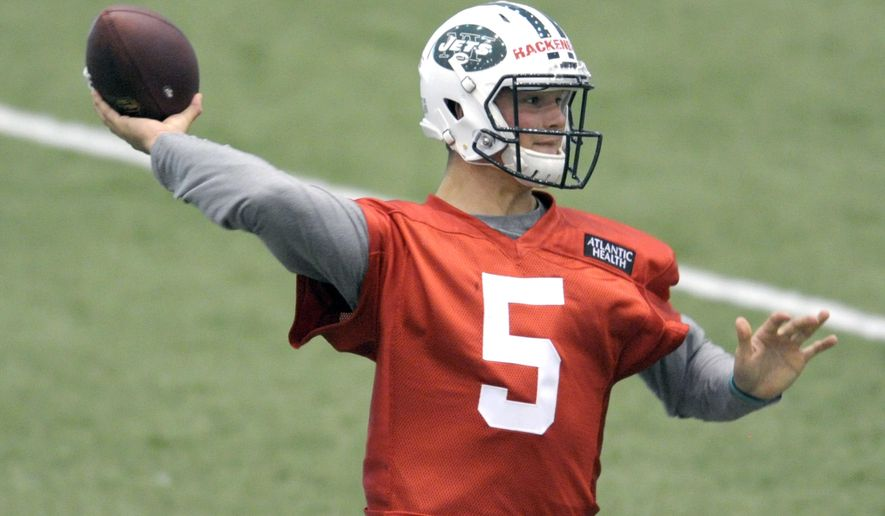 FILE - In a Friday, May 6, 2016 file photo, New York Jets second round draft pick Christian Hackenberg throws a pass during NFL football rookie minicamp, in Florham Park, N.J. The second-round draft pick from Penn State had an up-and-down NFL debut in the Jets' 21-20 loss to the Giants on Saturday night, Aug. 27, throwing a touchdown pass on his first drive. Hackenberg also threw an interception in Jets territory that set up the Giants' go-ahead score. (AP Photo/Bill Kostroun, File)