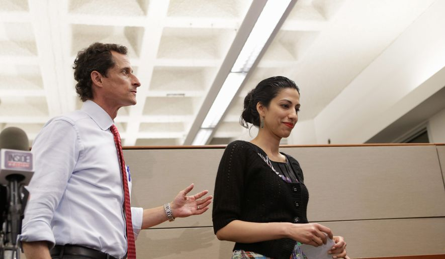 New York City mayoral candidate Anthony Weiner and his wife Huma leave a press conference at the Gay Men's Health Crisis headquarters, Tuesday, July 23, 2013, in New York. (AP Photo/Kathy Willens) ** FILE **