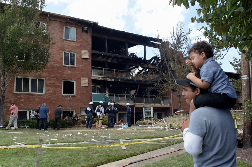 People survey the damage of the Aug. 10 explosion at the Flower Branch Apartments in Silver Spring, Maryland, that injured dozens and left seven people dead, including two children. (associated Press)