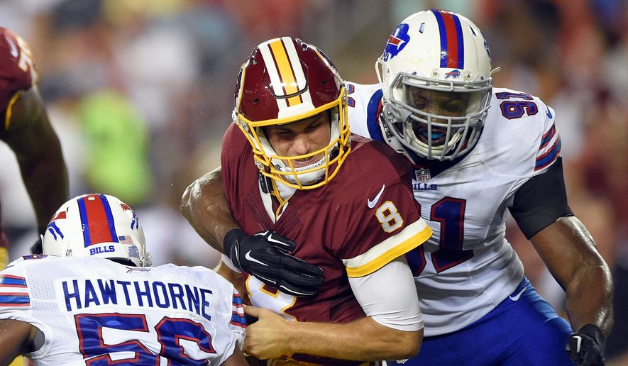 Quarterbacks like the Washington Redskins' Kirk Cousins, are protected by new rules that produce 15-yard penalties for hitting from the shoulders up or knees down. (Associated Press)
