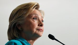 Democratic presidential candidate Hillary Clinton, donning her martyr's veil, claims to be under siege from American right-wing groups. (Associated Press)