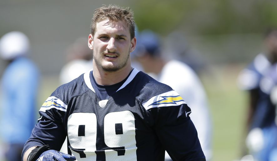 FILE - In this May 13, 2016, file photo, San Diego Chargers rookie defensive end Joey Bosa trains during an NFL football rookie training camp in San Diego. Bosa's holdout has overshadowed everything else going on with the Chargers, who went public with the contract dispute.  (AP Photo/Gregory Bull, File)