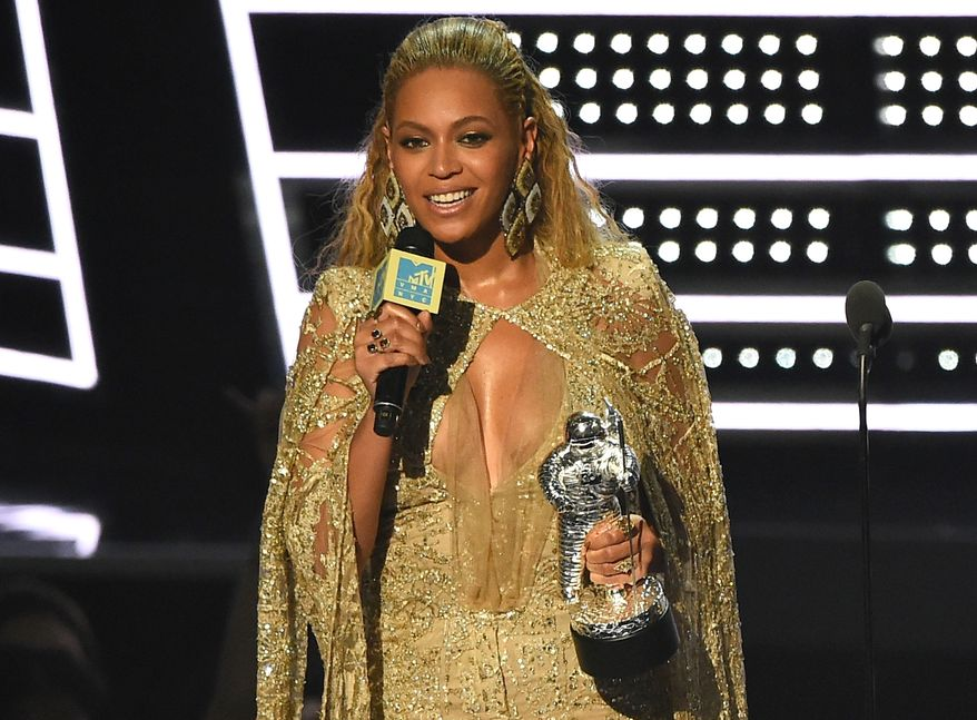 """Beyonce accepts the award for best female video for """"Hold Up"""" at the MTV Video Music Awards at Madison Square Garden on Sunday, Aug. 28, 2016, in New York. (Photo by Charles Sykes/Invision/AP)"""