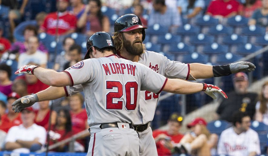 Washington Nationals' Jayson Werth, right, celebrates the home run with Daniel Murphy, left, during the first inning of a baseball game against the Philadelphia Phillies, Monday, Aug. 29, 2016, in Philadelphia. The Nationals won 4-0. (AP Photo/Chris Szagola)