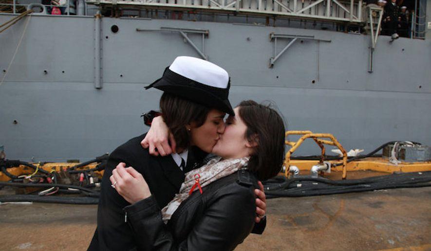 Petty Officer 2nd Class Marissa Gaeta, left, kisses her girlfriend, Petty Officer 3rd Class Citlalic Snell at Joint Expeditionary Base Little Creek in Virginia Beach, Va. on Wednesday, Dec. 21, 2011. (Brian J. Clark/The Virginian-Pilot via Associated Press) ** FILE **