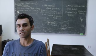 In this photo taken on Monday, Aug. 8, 2016, Uygar Ozdemir, 36, high school sports teacher speaks during an interview with the Associated Press in Istanbul. Teachers caught up in one of biggest dragnets in Turkish history as government seeks to root out followers of Islamic cleric it blames for coup attempt. Ozdemir had been suspended from his job in an Istanbul school, accused of providing financial support for a terrorist organization and promoting the organization on social media. (AP Photo/Thanassis Stavrakis)