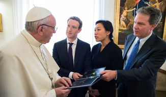 Pope Francis meets Facebook founder and CEO Mark Zuckerberg, second from left, and his wife Priscilla Chan, at the Santa Marta residence, the guest house in Vatican City where the pope lives, Monday, Aug. 29, 2016. Vatican spokesman Greg Burke says a topic of discussion at Mondays meeting was how to use communication technologies to alleviate poverty, encourage a culture of encounter, and make a message of hope arrive, especially to those most in need. (L'Osservatore Romano/Pool Photo via AP)