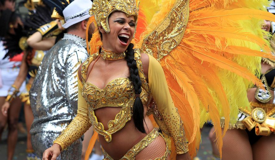 A reveler takes part in the Monday parade, during the second and final day of the Notting Hill Carnival, in London, Monday Aug.  29, 2016. (Jonathan Brady/PA via AP)