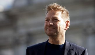 FILE- In this March 16, 2015 file photo,  director Kenneth Branagh poses for photographers during the presentation of the film 'Cinderella' in Madrid. It was announced on April 17, 2015 that Branagh will stage a season of London plays with a cast including actors  Judi Dench and Richard Madden(AP Photo/Abraham Caro Marin, File)