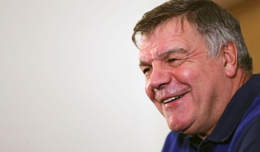 England soccer team manager Sam Allardyce, smiles during the press conference at St George's Park, Burton central England Monday Aug. 29, 2016.  England will play Slovakia in a World Cup qualifying group match in Slovakia on Sunday. (Simon Cooper/PA via AP)