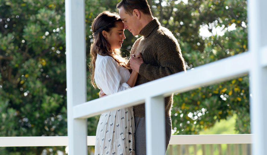 """This image released by Dreamworks II shows Alicia Vikander, left, and Michael Fassbender in a scene from, """"The Light Between Oceans."""" (Davi Russo/Dreamworks II via AP)"""