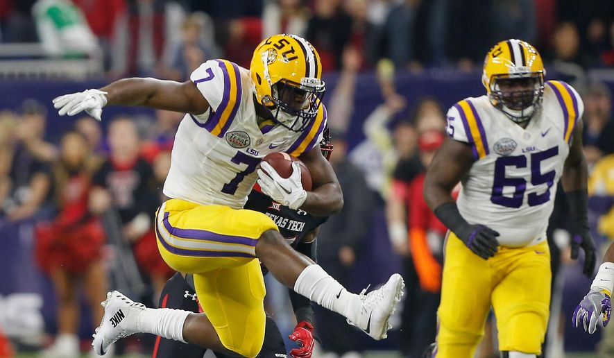 FILE - In this Dec. 29, 2015, file photo, LSU running back Leonard Fournette (7) hurdles tight end Colin Jeter (81) as he rushes against Texas Tech during the first half of the Texas Bowl NCAA college football game in Houston. All eyes are on Fournette as fifth-ranked LSU enters Week 1 of a highly anticipated season. (AP Photo/Bob Levey, File) **FILE**