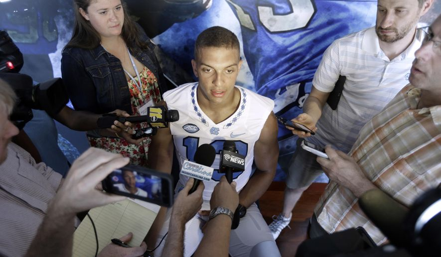 FILE - In this Aug. 6, 2016, file photo, North Carolina wide receiver Mack Hollins speaks to members of the media during the NCAA college football team's media day in Chapel Hill, N.C. No. 22 North Carolina won't have Hollins for the first half of Saturday's opener against No. 18 Georgia due to a targeting penalty from last season's bowl game.  (AP Photo/Gerry Broome, File)