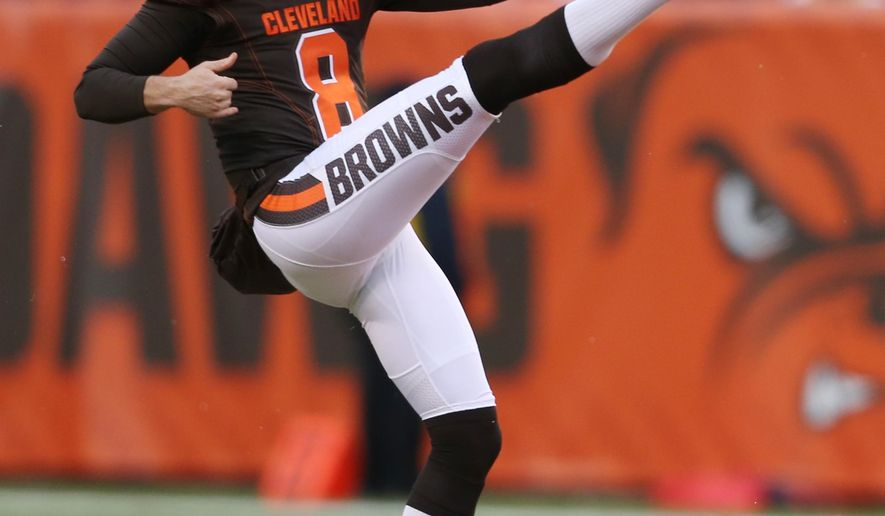 This  Jan. 3, 2016 photo shows Cleveland Browns punter Andy Lee (8) kicking against the Pittsburgh Steelers during the first half of an NFL football game in Cleveland. The Cleveland Browns have traded Lee to Carolina for punter Kasey Redfern and a 2018 fourth-round pick. (AP Photo/Ron Schwane)