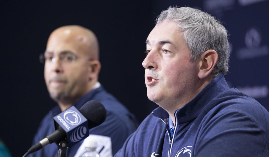 FILE - In this Dec. 16, 2015, file photo, New Penn State offensive coordinator Joe Moorhead speaks at an introductory press conference in State College, Pa., as head coach James Franklin looks on.  Moorhead's ability to deliver an offense that can help the Nittany Lions close the gap on Ohio State, Michigan and Michigan State in the Big Ten East will likely play a huge part in determining Franklin's future at Penn State.(Joe Hermitt /PennLive.com via AP, File) **FILE**