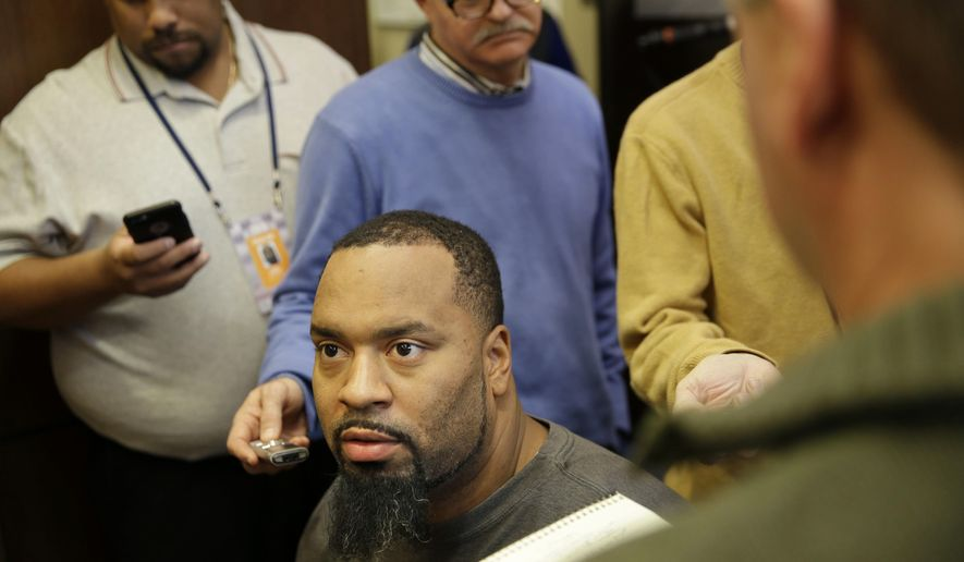 FILE - In this Jan. 4, 2016, file photo, then-New York Giants' Cullen Jenkins talks to reporters in the team locker room in East Rutherford, N.J. Seeking depth on the defensive line, the Washington Redskins signed veteran Cullen Jenkins to a one-year deal Monday, Aug. 29, 2016. The team announced the deal shortly after Jenkins worked out and just before he took the field for practice. (AP Photo/Seth Wenig, File)
