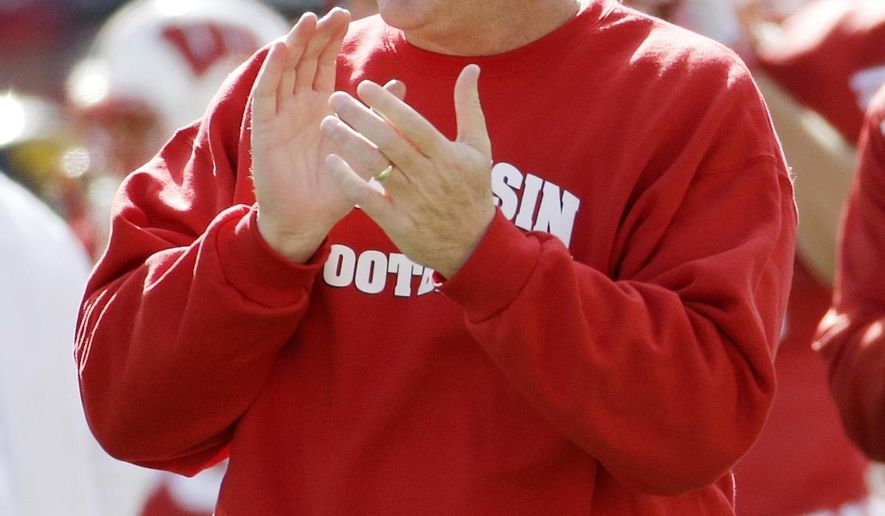 FILE - In this Oct. 3, 2015, file photo, Wisconsin head coach Paul Chryst gestures on the sideline before an NCAA college football game against Iowa, in Madison, Wisc. Year 2 of Chryst's tenure at Wisconsin starts with a high-profile game that could define the Badgers' season: No. 5 LSU at Lambeau Field on Saturday. (AP Photo/Morry Gash, File)