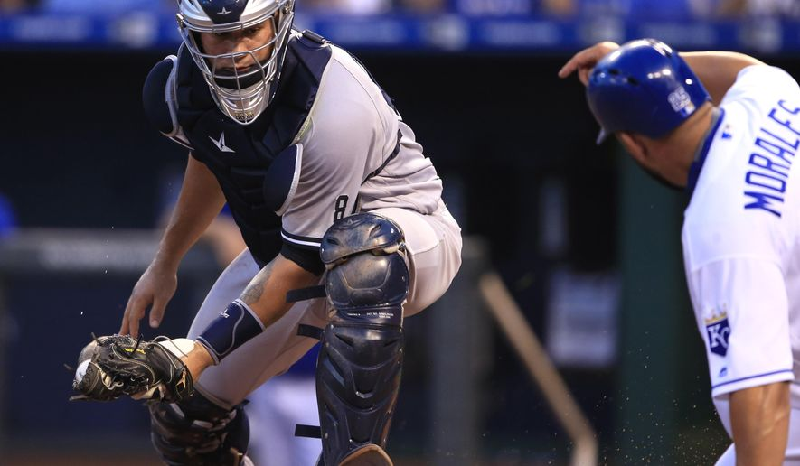 New York Yankees catcher Gary Sanchez, left, fails to tag Kansas City Royals' Kendrys Morales, right, during the first inning of a baseball game at Kauffman Stadium in Kansas City, Mo., Monday, Aug. 29, 2016. Morales scored on a hit by teammate Jeff Gordon. (AP Photo/Orlin Wagner)