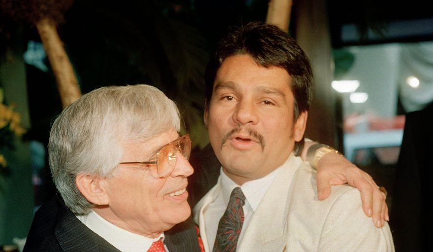 "According to ""Hands of Stone,"" trainer Ray Arcel (left0 helped sell boxer Roberto Duran as an opponent for junior middleweight champion Davey Moore. (Associated Press)"