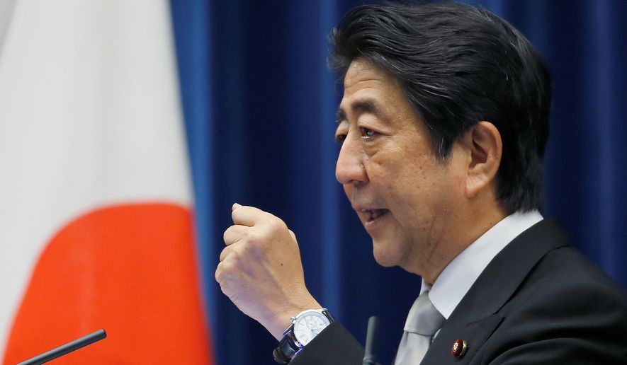 Japanese Prime Minister Shinzo Abe declared a reinterpretation of his constitution to allow Japanese forces to come to the aid of attacked allies. (Associated Press)