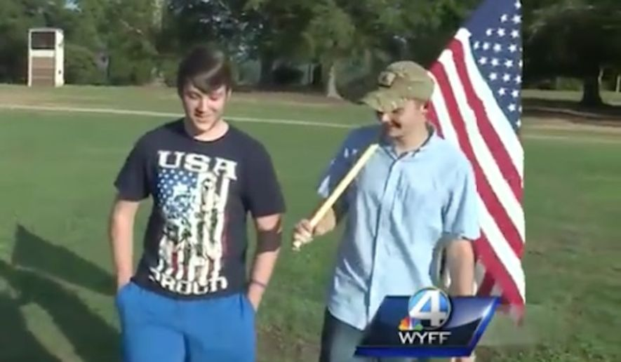 Haiden McCall and Noah Cutler, students at Travelers Rest High School, said they were denied entry to Friday night's game because of their American flags.