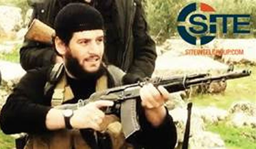 "This undated militant image provided by SITE Intel Group shows Abu Muhammed al-Adnani, the Islamic State militant group's spokesman who IS say was ""martyred"" in northern Syria. The IS-run Aamaq news agency said Tuesday, Aug. 30, 2016 that al-Adnani was ""martyred while surveying the operations to repel the military campaigns against Aleppo,"" without providing further details. (SITE Intel Group via AP)"